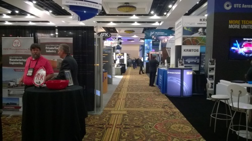 Exhibition hall after it opened.  Note the booths in the foreground are regular size.  The ones from NG, Boeing, LockMar, and others are huge.  Thank you taxpayers for lucrative contracts!!
